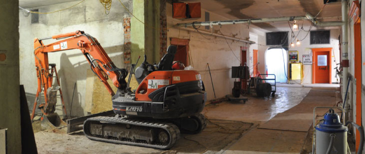Lower-hall-with-excavator_731x308