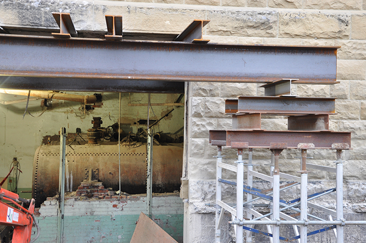 Structural steel supporting opening in sandstone wall