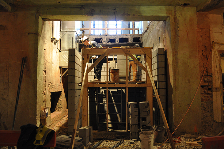 Masons shape up new  elevator shaft on 1st floor