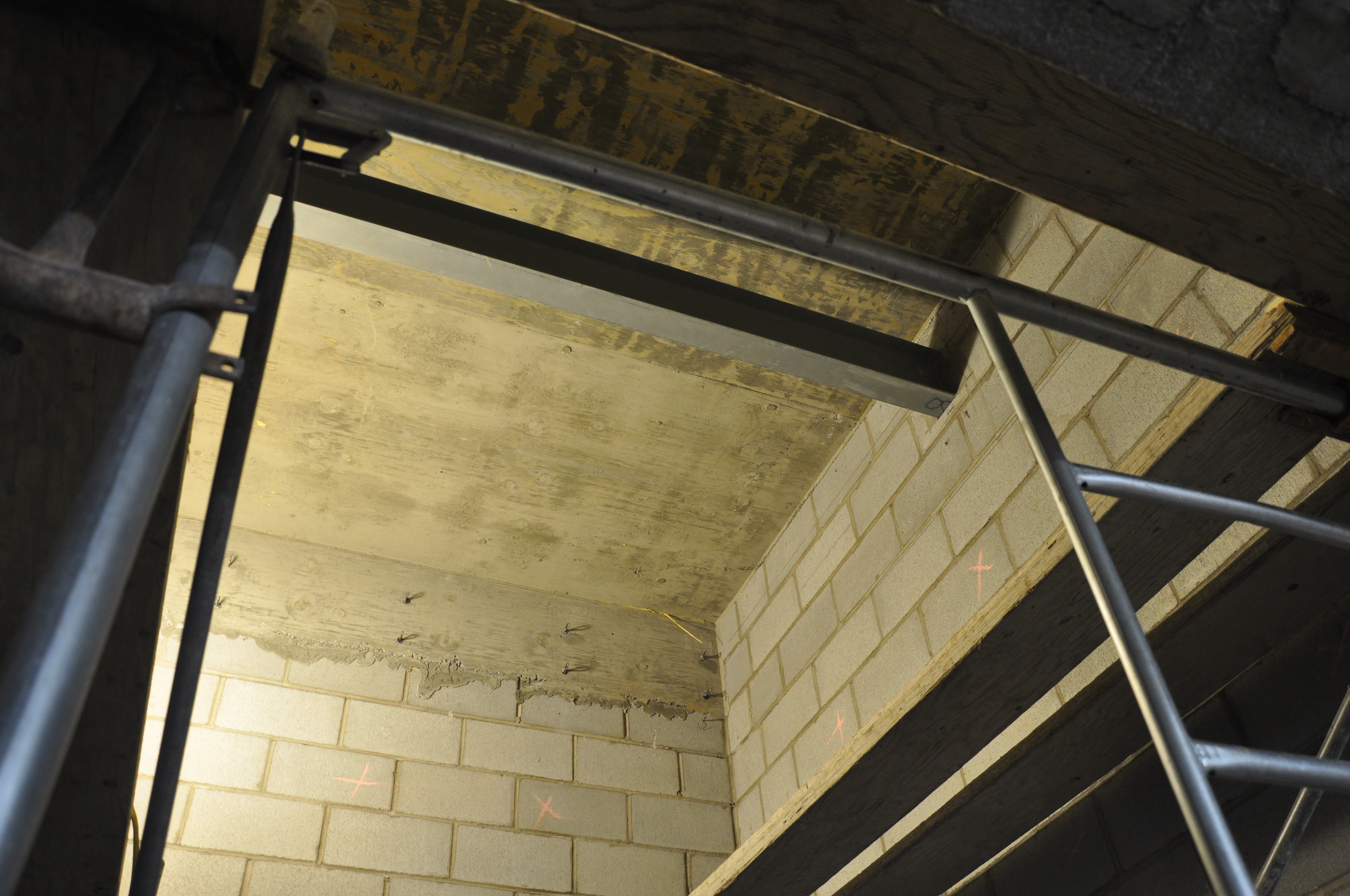 Top interior of elevator shaft with steel carrier beam