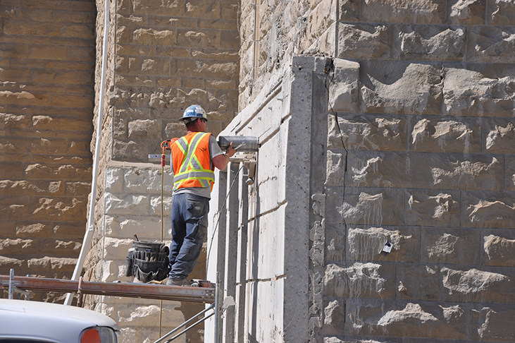 Cores being cut into 1950s concrete wall
