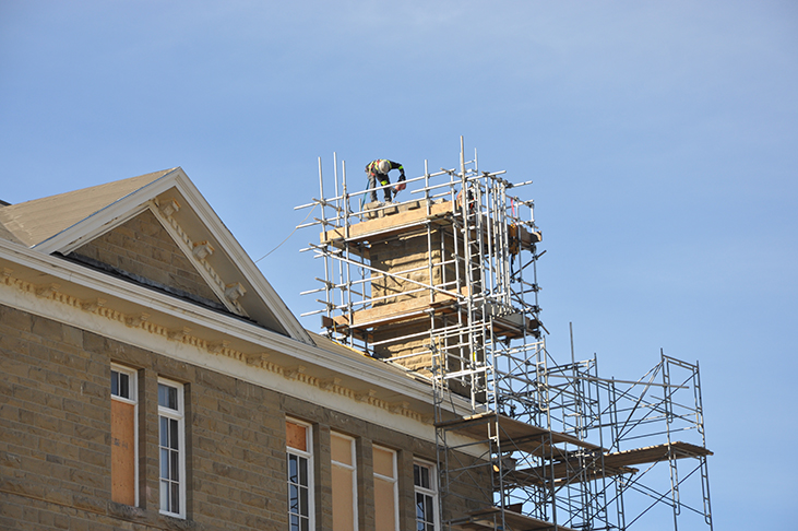 Dismantling historic chimney atop King Edward