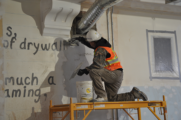 Artist Mark Vazquez-MacKay's painting of Chris Demeanour's poetic verse hidden beneath new plaster repairs