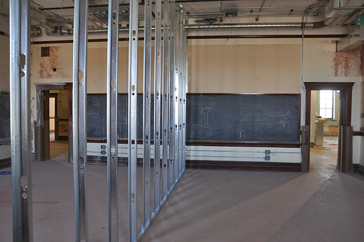 Framing in place to divide historic classroom