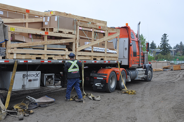Flatbed delivers elevator as a kit of parts for installation