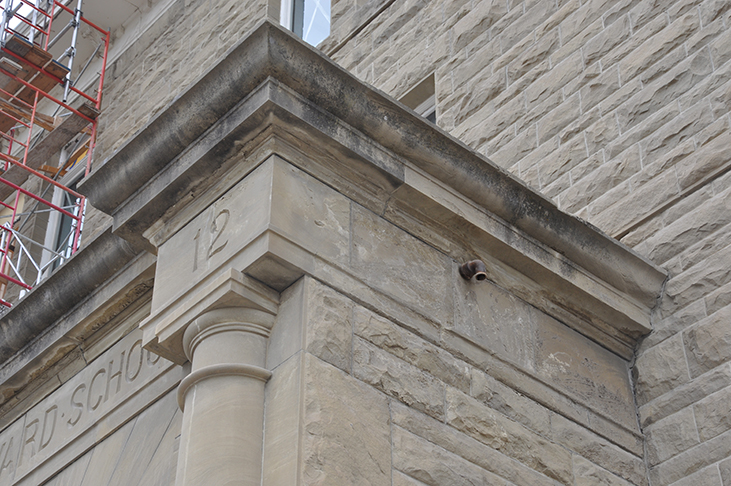 Weathered sandstone at historic main entrance