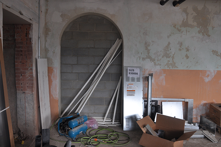 Historic archway infilled with cement block to meet current building code