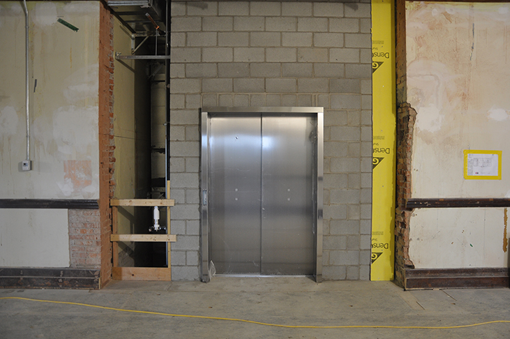 Elevator door installed and awaiting commissioning
